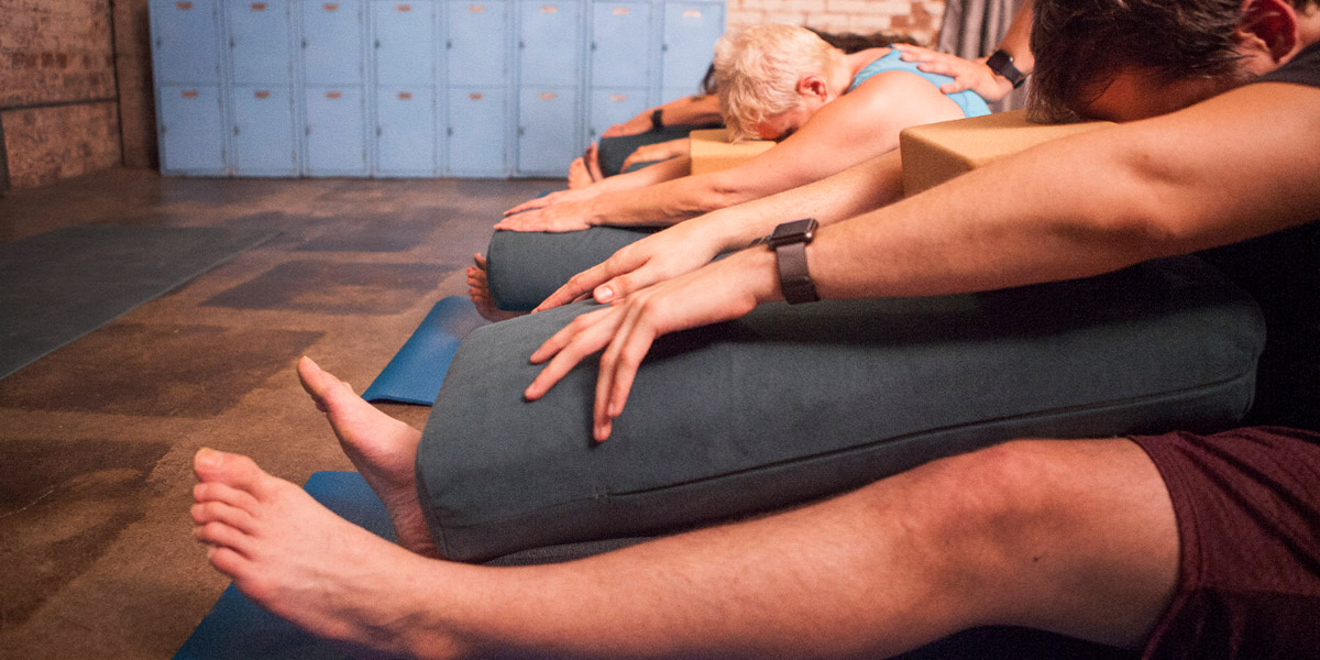 Therapeutic yoga class using bolsters