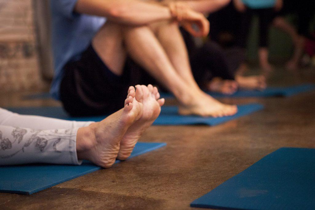 Feet on yoga mat