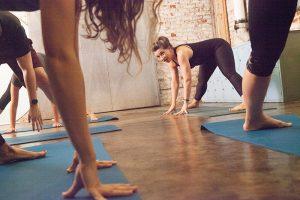 Vinyasa yoga class shot from the floor