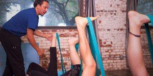 Yoga using straps